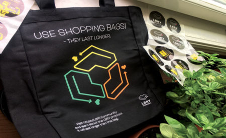 The Elegant Community Shopping Bag and some crazy stickers.